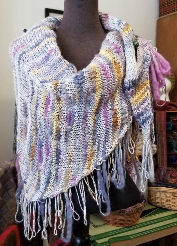 Multi colored textured self fringing shawl