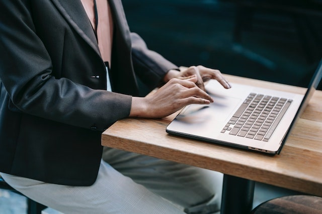Business professional typing on a laptop
