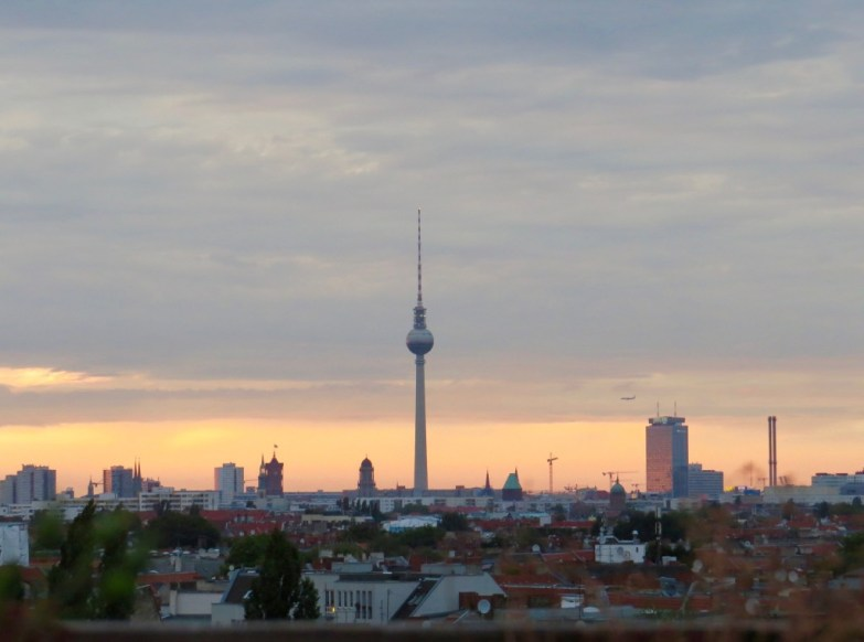 Sunset over Berlin from KlunkerKranich, an alternative rooftop bar.