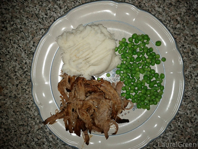 a photograph of a plate of slow-cooked, mashed potatoes and peas