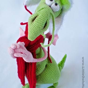 http://www.ravelry.com/patterns/library/026-dragon-with-a-hat-and-scarf-ravelry