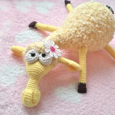 http://www.ravelry.com/patterns/library/dolly-the-sheep-amigurumi-fluffy-toy