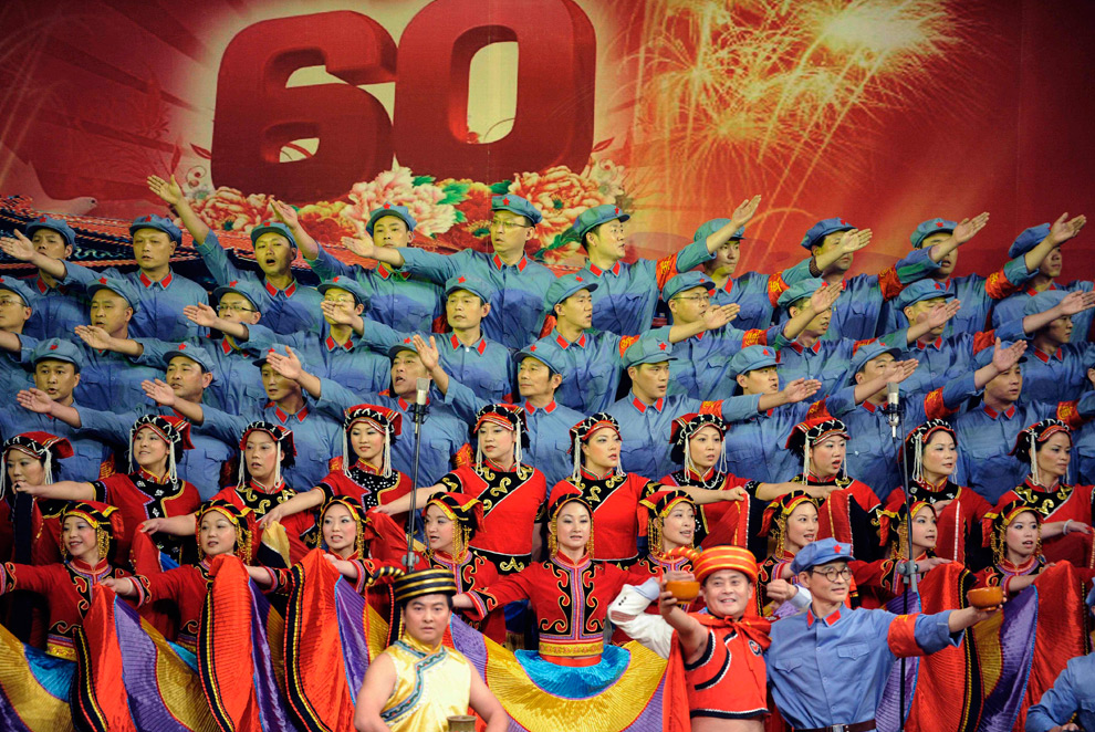 Chinese government workers dressed in traditional costumes take part in a competition of singing patriotic songs in Chengdu in southwestern Chinas Sichuan province, Thursday Sept. 17, 2009. -- Via AP/Boston.com