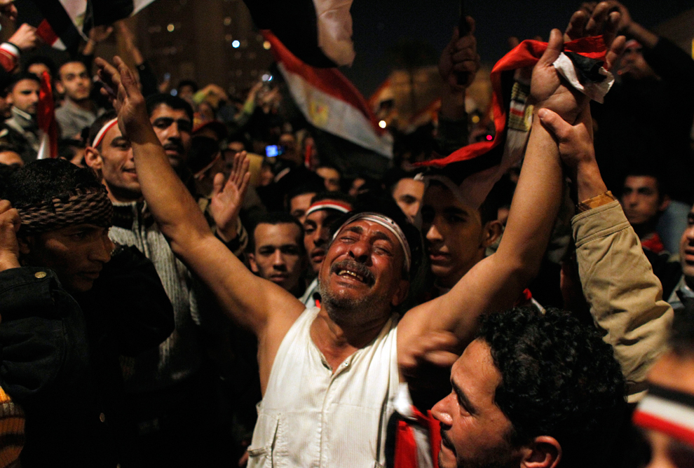 After Egypt's military announced on national television that the protesters' demands would be met, the crowd celebrates. That joy turned to seething anger hours later when President Mubarak vowed to stay in office until September. (Tara Todras-Whitehill/Associated Press)