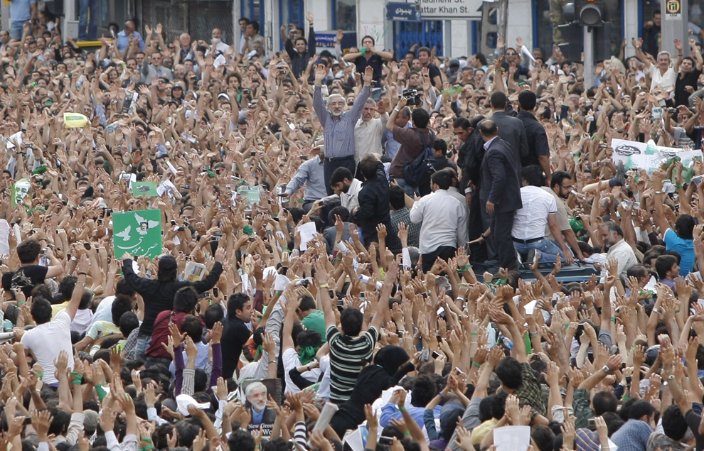 This photo is from June 15th, taking during Mousavis first public appearance after the protests began (Mousavi is the man in the middle of the picture with his arms raised, wearing a grey shirt). Although it is a few days old, I thought it too inspirational not to share with you.