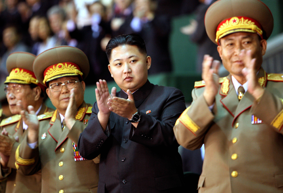 In this photo taken on Saturday, Oct. 9, 2010 released by China's Xinhua News Agency, Kim Jong Un, third from left, the third son of North Korean Leader Kim Jong Il, applauds while watching the Arirang mass games performance in Pyongyang, North Korea