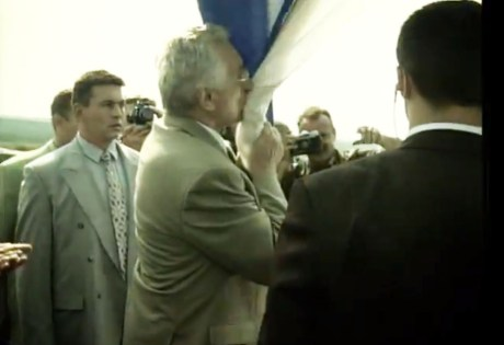 Franjo Tudjman kisses the Croatian flag in liberated Knin August 6, 1995