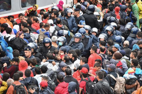 Croatia - Tovarnik Refugees pushing to get on train to Slovenia October 2015 Photo: AP