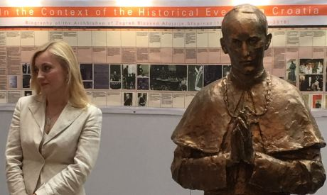 Marijana Petir, MEP in Brussels 14 June 2016 at side of statue of Blessed Alojzije Stepinac