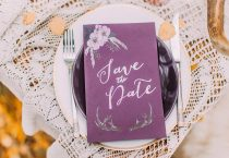 Lovely purple postcard on the plate with lace towels close up