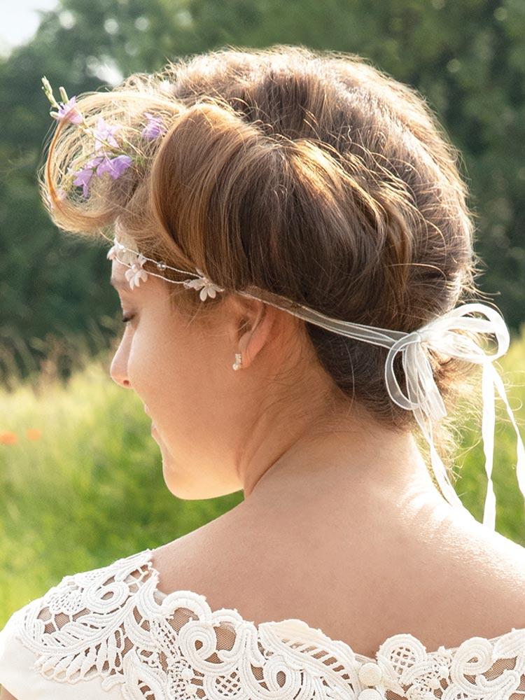 Vintage-Brautfrisur hockgesteckt