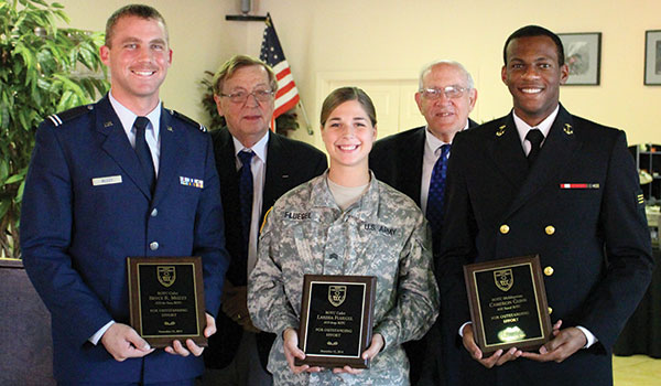 Front row, left to right: Cadet Bryce Muzzy, of the Air Force ROTC; Cadet Larissa Fluegel, of the Army ROTC; and Midshipman Cameron Gunn, of the Navy ROTC.  Back row, left to right: Tom Waldron and Dr. David Gorley.