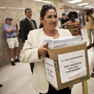 Dolores Canales, co-founder of California Families to Abolish Solitary Confinement, carries papers and a box representing 60,000 signatures protesting indefinite solitary confinement in California prisons, to Governor Jerry Brown's office at the State Capitol in Sacramento, California July 30, 2013. Hundreds of inmates are in the 23rd day of a hunger strike in protest of indefinite solitary confinement. REUTERS/Max Whittaker (UNITED STATES - Tags: CIVIL UNREST CRIME LAW SOCIETY)
