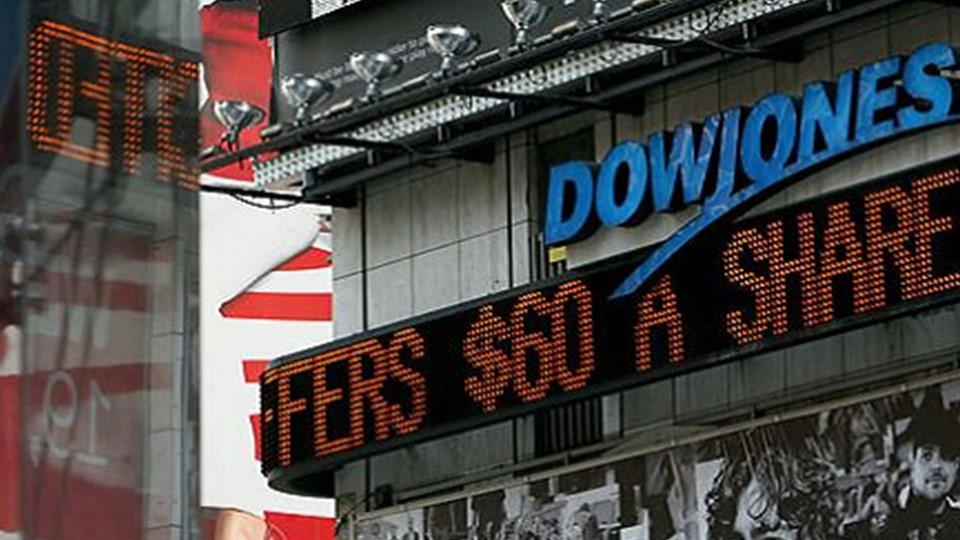 The picture shows an electronic scoreboard with the luminous writing Dow Jones