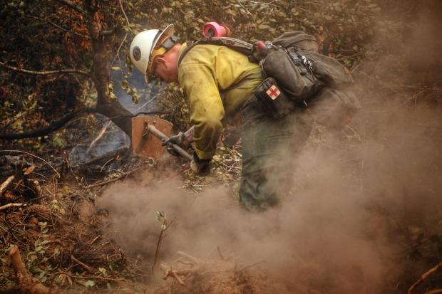 9/14/20 Firefighter from Galice Wildland Fire Module securing the containment lines edge near Goodwish road, Dwight Creek and Almost Heaven off Hwy 199