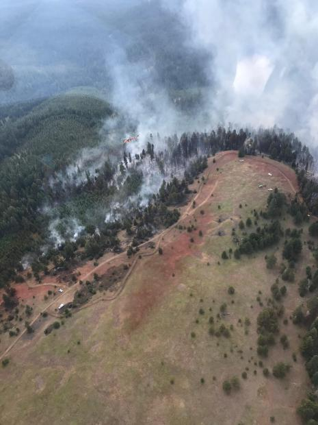Aerial view of the Matlock Fire on July 29, 2020, showing successful retardant drops slowing fire growth.