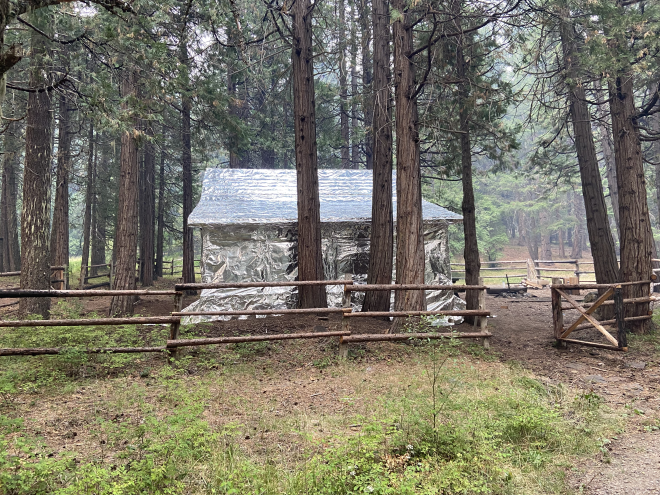 Picture of Whisky Camp Guard Station completely wrapped to protect it from fires.