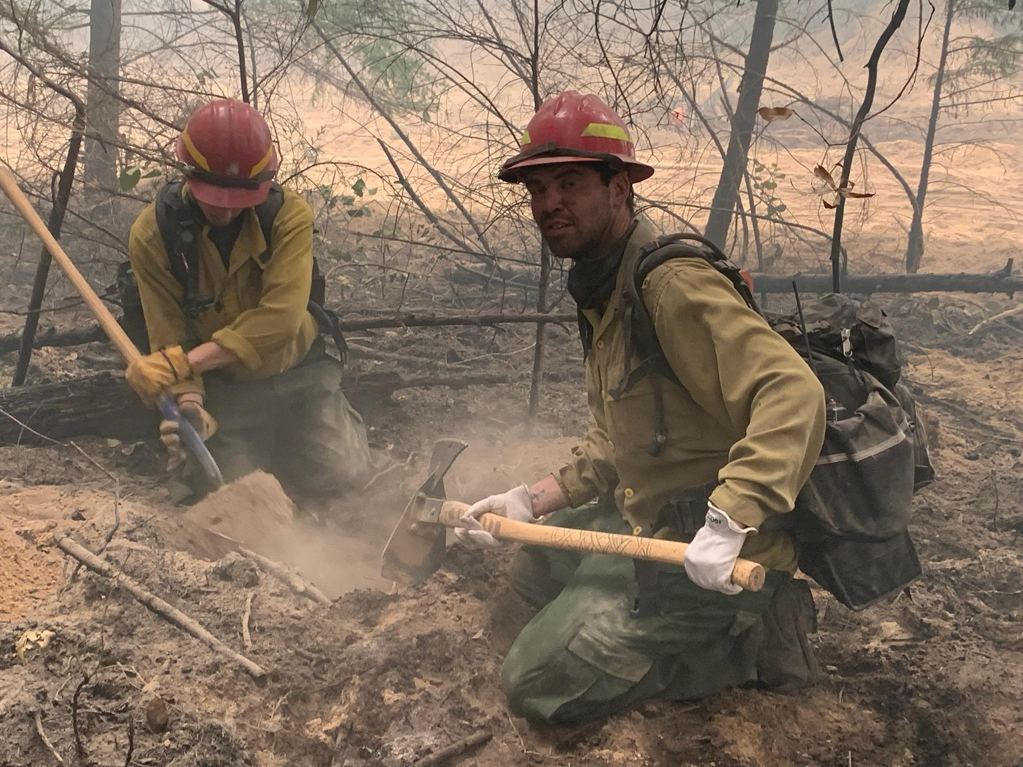 Fire fighters working on a hot spot on the Devil's Knob Complex
