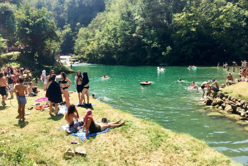 People bathing in river