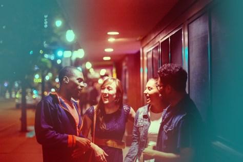 Students talk on outside on Green Street. Photo courtesy of the University of Illinois.