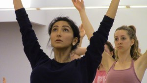 """A student concentrates during a """"Body Flow"""" yoga class, held as part of Illini Wellness Week, on Wednesday, April 8."""