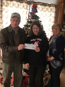 Representative of St. Andrews Masonic Lodge presents cheque to client of Inclusions East