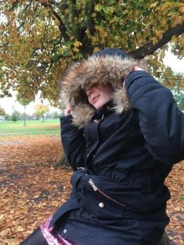 Girl under an autumn tree sensory story