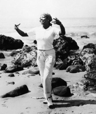 Maya Angelou Walking Along Beach