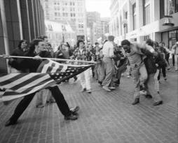Man uses American flag to assault civil rights activist.1976