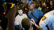 Missouri-State-Highway-Patrol-Captain-Ron-Johnson-speaks-to-a-protester-wearing-a-Guy-Fawkes-mask-while-he-walks-through-a-peaceful-demonstration-as-communities-continue-to-react-to-the-shooting-of-Michael-
