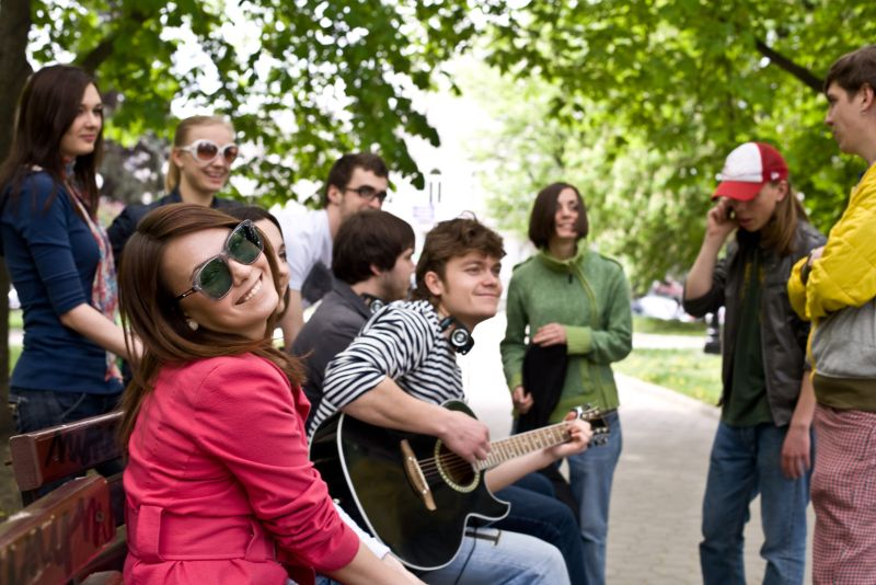 music with friends in a park