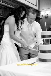 #259- Mr. and Mrs. Rohman cut their vintage inspired wedding cake.