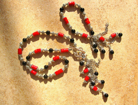 Coral jewellery with black agate