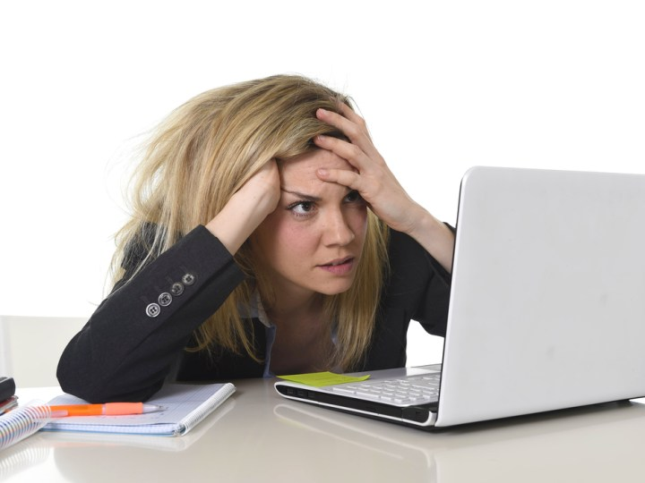 Frustrated person working on a computer