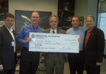 Gary Lawson receiving check from American Airlines