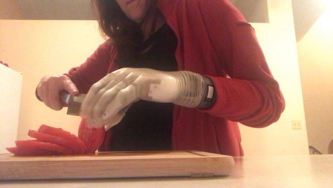 Carrie chopping tomato using Luke Arm