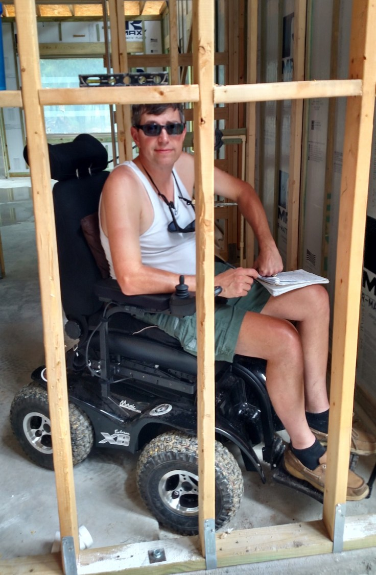 Kevin St. Amant in chair inside house being built