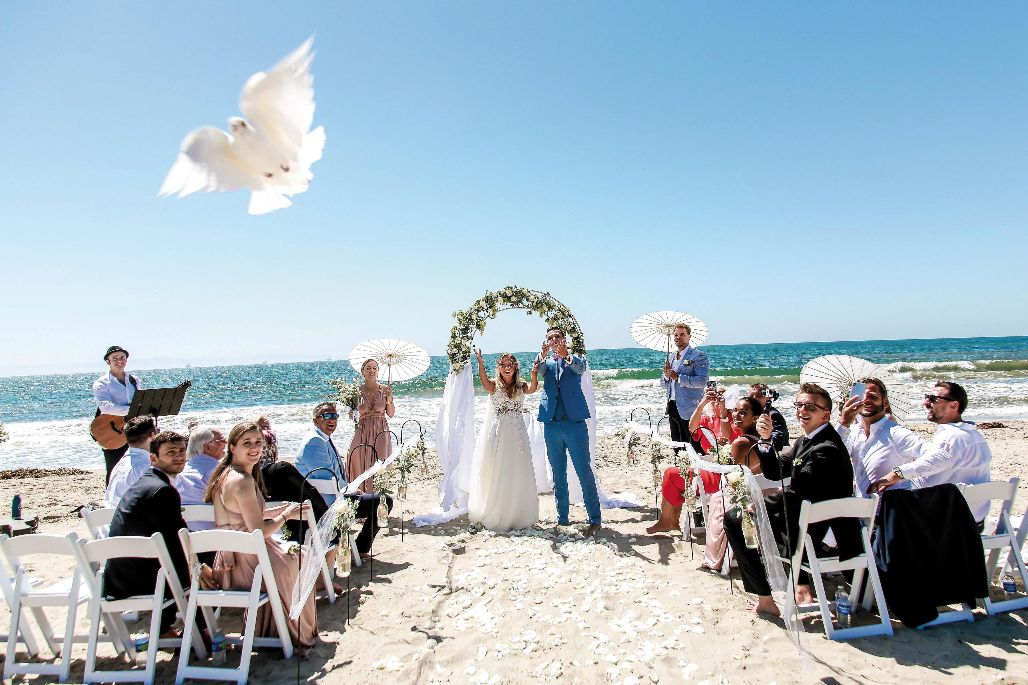 7b0a30163ada Love is abundant at this S.B. sand-and-sea wedding.Head Heart Photography