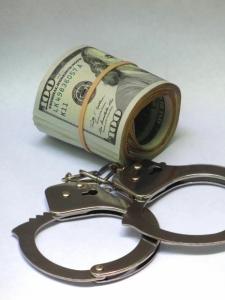 theft arrest money handcuffs