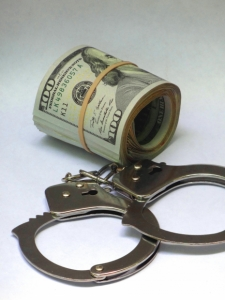 theft arrest money handcuffs