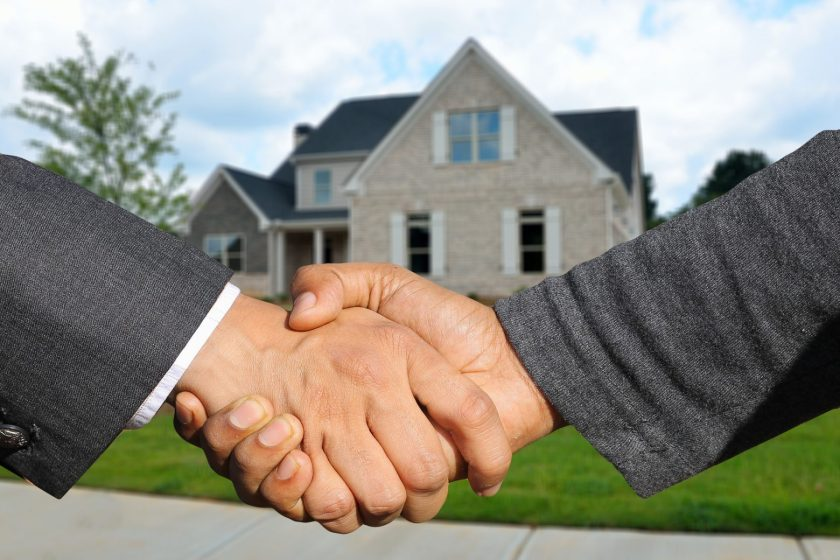 Real estate investment homeownership handshake