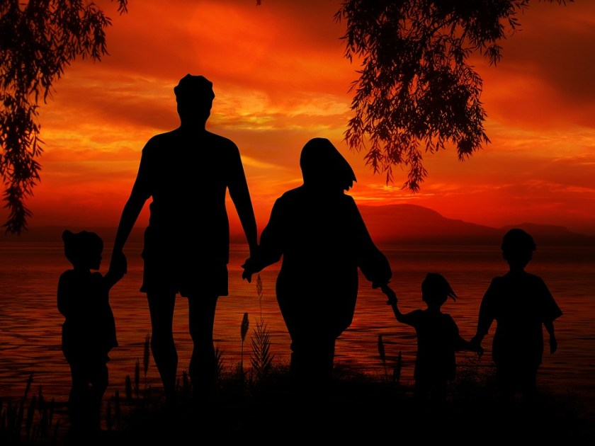 Parents-children-at-beach-sunset-silhouette