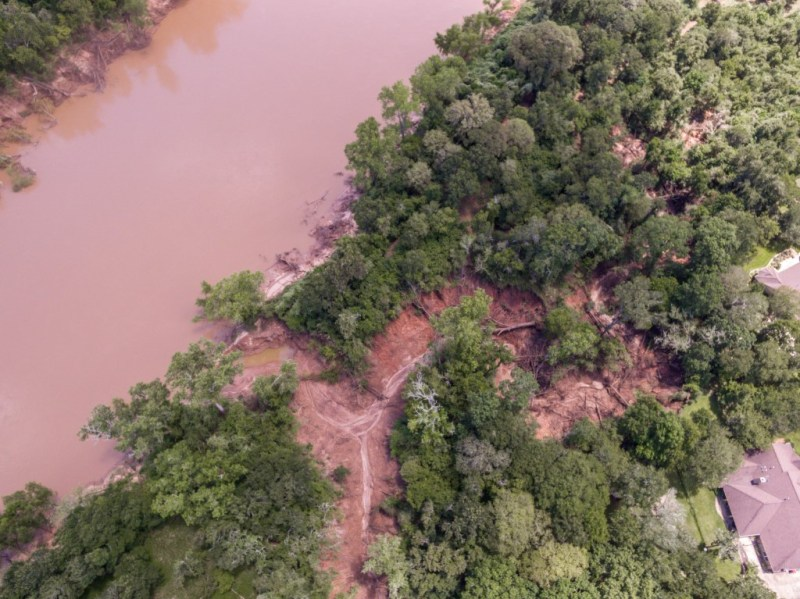 Drone images of erosion and encroachment of water from the ravine behind the homes of the Nixons and their neighbor
