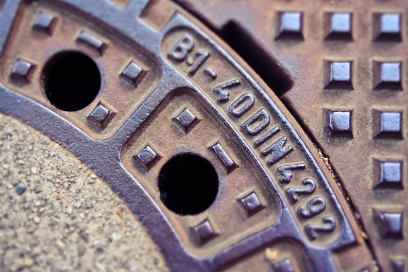 Metal sewage sewer manhole cover