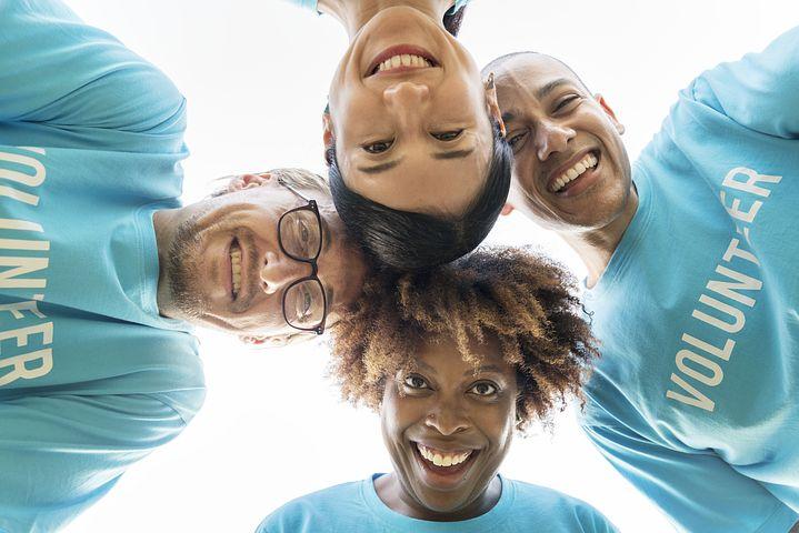Homeowner volunteers faces smiling