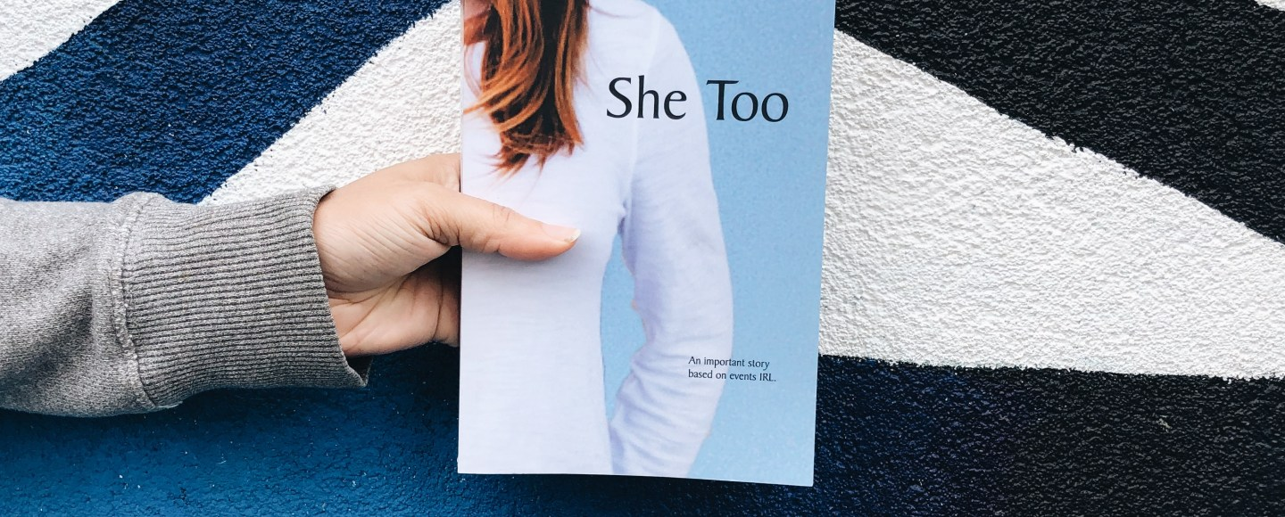 This is an original photograph of a person holding She Too by R. Read, reviewed by Independent Book Review