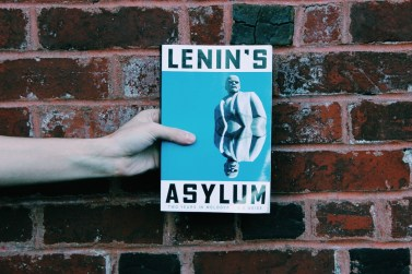 Picture of Independent Book Review editor-in-chief Joe Walters holding copy of Lenin's Asylum by A.A. Weiss