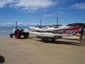 Kayak transport at beach, Marahau
