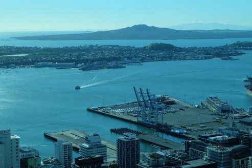 Looking northeast from the Sky Tower toward Rangitoto with a view of the Queen's Wharf and the harbor.