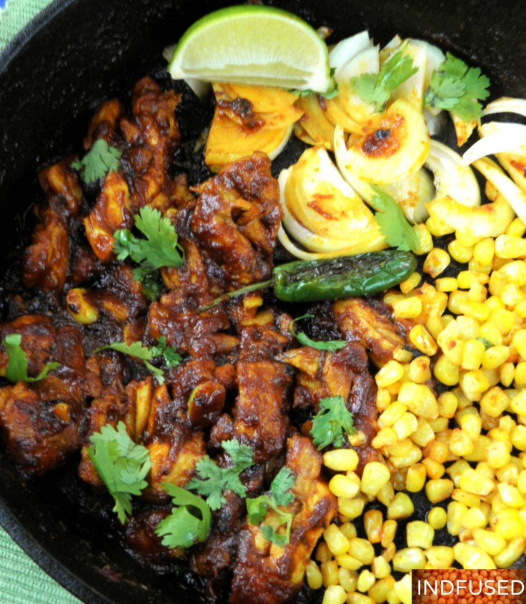 Tender chicken coated with Indian vindaloo sauce, gluten free,Indo mexican fusion one pan meal with guacamole and red cabbage toppings